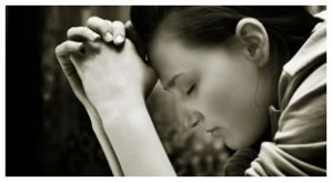 "Photo Credit: ""Young Woman Praying"" from blogs.voices.com"